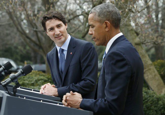 美国总统欧巴马(右)每年领40万美元,排名第一.加拿大总理杜鲁多